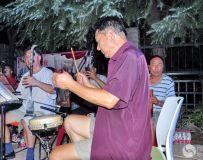 司鼓老师。