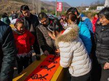义写春联3——内乡县文化科技医疗三下乡活动拍摄