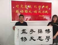 南阳市社区志愿者协会公益宣讲团党支部走进高新消防大队泼墨书画庆八一图3